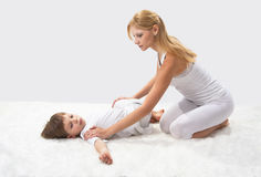 Mother and son do yoga Royalty Free Stock Photo