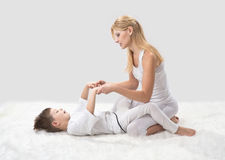 Mother and son do yoga Stock Photo