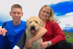 Mother, Son and dog. Mather and son holding their wheaten terrier dog Stock Photography