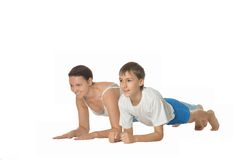 Mother and son doing exercises Royalty Free Stock Photos