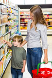 Mother and son doing grocery shopping Royalty Free Stock Photos