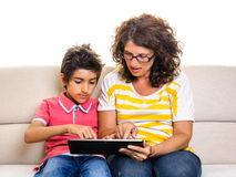 Mother and son doing homework digital tablet pc Royalty Free Stock Photo