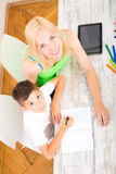 Mother and son doing homework Stock Images