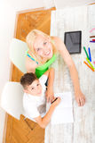 Mother and son doing homework Royalty Free Stock Photo