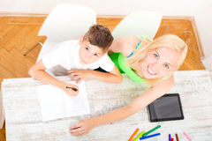 Mother and son doing homework. A mother helping his son with his homework stock photos