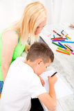 Mother and son doing homework. A mother helping his son with his homework Stock Photography