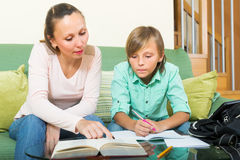 Mother with son doing homework Stock Images