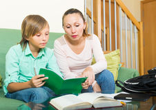 Mother with son doing homework Royalty Free Stock Photography