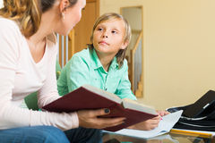Mother with son doing homework Stock Photos