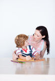 Mother and son doing homework together Stock Image