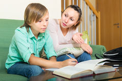 Mother and son doing homework Stock Photos