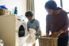 Mother and son doing housework together Stock Photography