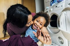 Mother and son doing housework together Stock Photo