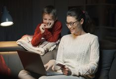Mother and son doing online shopping together stock photography