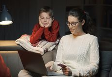 Mother and son doing online shopping together royalty free stock photos