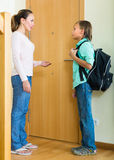 Mother with son at doorway Stock Images