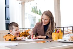 Mother and son draw drawing hands colored pencils Stock Image
