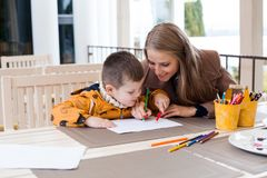 Mother and son draw drawing hands colored pencils Royalty Free Stock Image