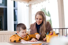Mother and son draw drawing hands colored pencils. 1 Stock Photos