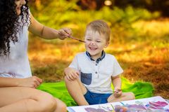 Mother and son draw. Concept of happy family. Mother and son draw outdoor. Concept of happy family royalty free stock photography