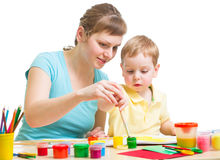 Mother and son drawing or painting together isolated Stock Photos