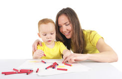 Mother and son are drawing the picture together Royalty Free Stock Photos