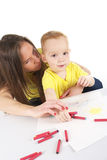 Mother and son are drawing the picture together Stock Image