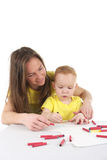 Mother and son are drawing the picture together Stock Photography