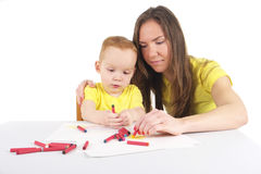 Mother and son are drawing the picture together Stock Photo
