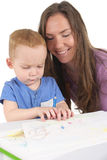 Mother and son are drawing the picture together Stock Photos