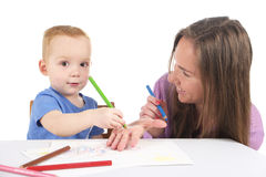 Mother and son are drawing the picture together Royalty Free Stock Photo