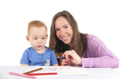 Mother and son are drawing the picture together Royalty Free Stock Photography