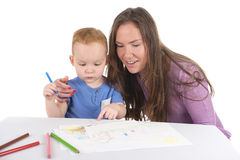 Mother and son are drawing the picture together Royalty Free Stock Images
