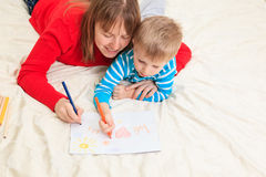 Mother and son drawing present for daddy Royalty Free Stock Photo