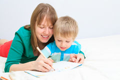 Mother and son drawing present for daddy Royalty Free Stock Photos