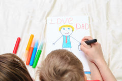 Mother and son drawing present for daddy Royalty Free Stock Photography