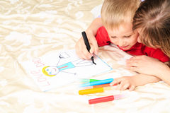 Mother and son drawing present for daddy. Family love Royalty Free Stock Images