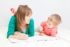 Mother and son drawing together Royalty Free Stock Images