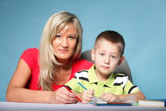 Mother and son drawing together Royalty Free Stock Photography