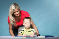 Mother and son drawing together Stock Photography