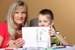 Mother and son drawing together Stock Image