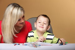 Mother and son drawing together Stock Photo