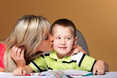 Mother and son drawing together Stock Photos