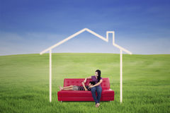 Mother and son in dream house outdoor Royalty Free Stock Images