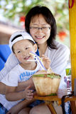 Mother son drink coconut happily Stock Image