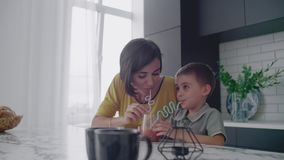 Mother and son drink the juice of the tubes. Mother and son drink the juice of the tubes stock video footage