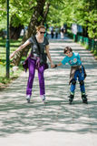 Mother and son driving inline skates Royalty Free Stock Image