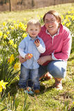 Mother And Son On Easter Egg Hunt Stock Photos