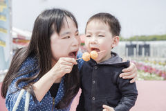 Mother and son eat octopus ball Stock Photography