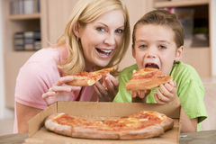 Mother And Son Eating Pizza Together Royalty Free Stock Photography